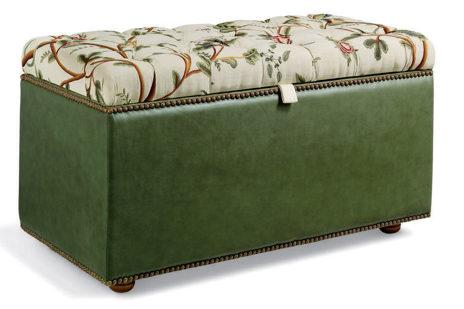 A FLORAL CREWELWORK AND GREEN LEATHER OTTOMAN