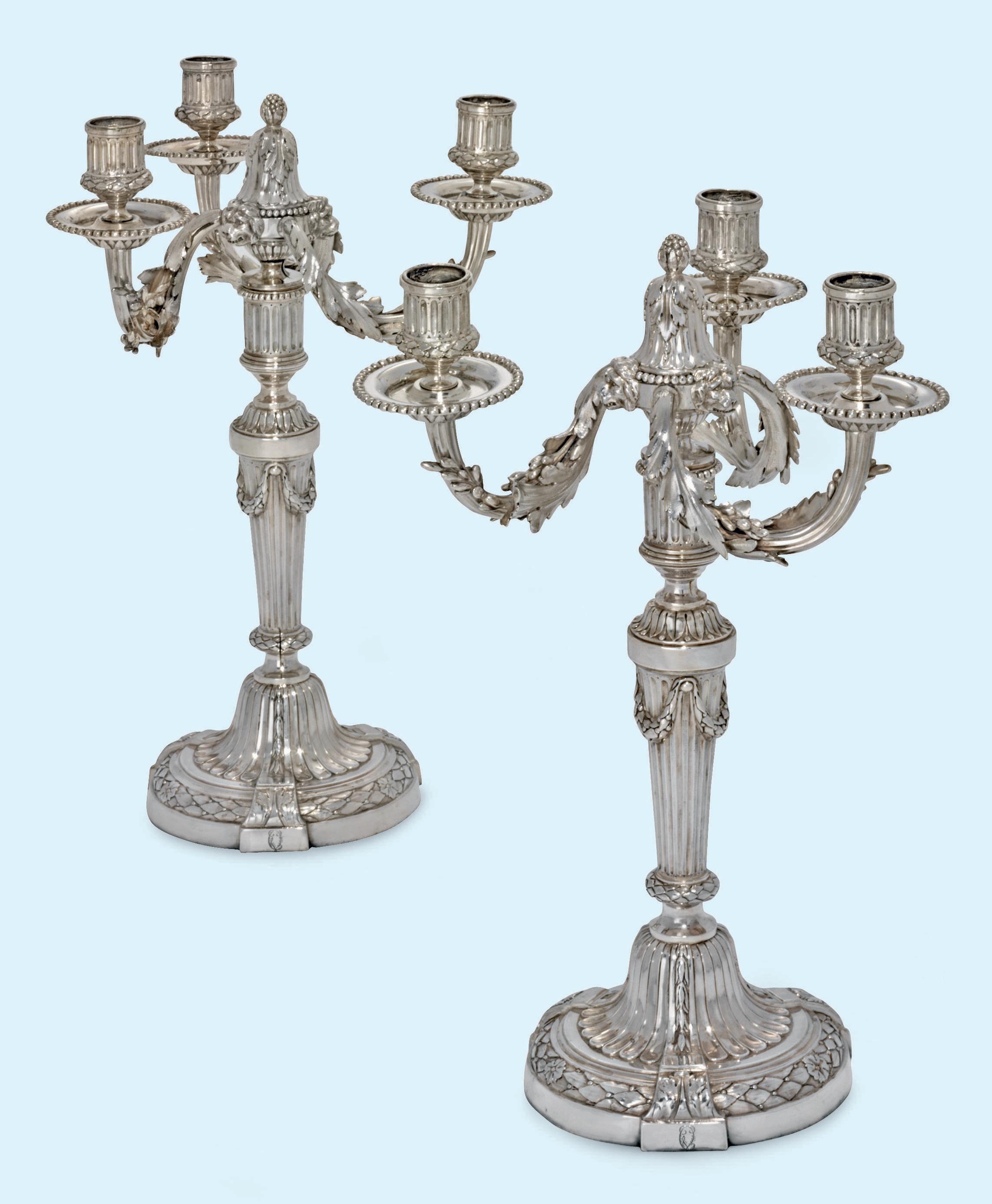 A PAIR OF LOUIS XVI SILVER THREE-LIGHT CANDELABRA