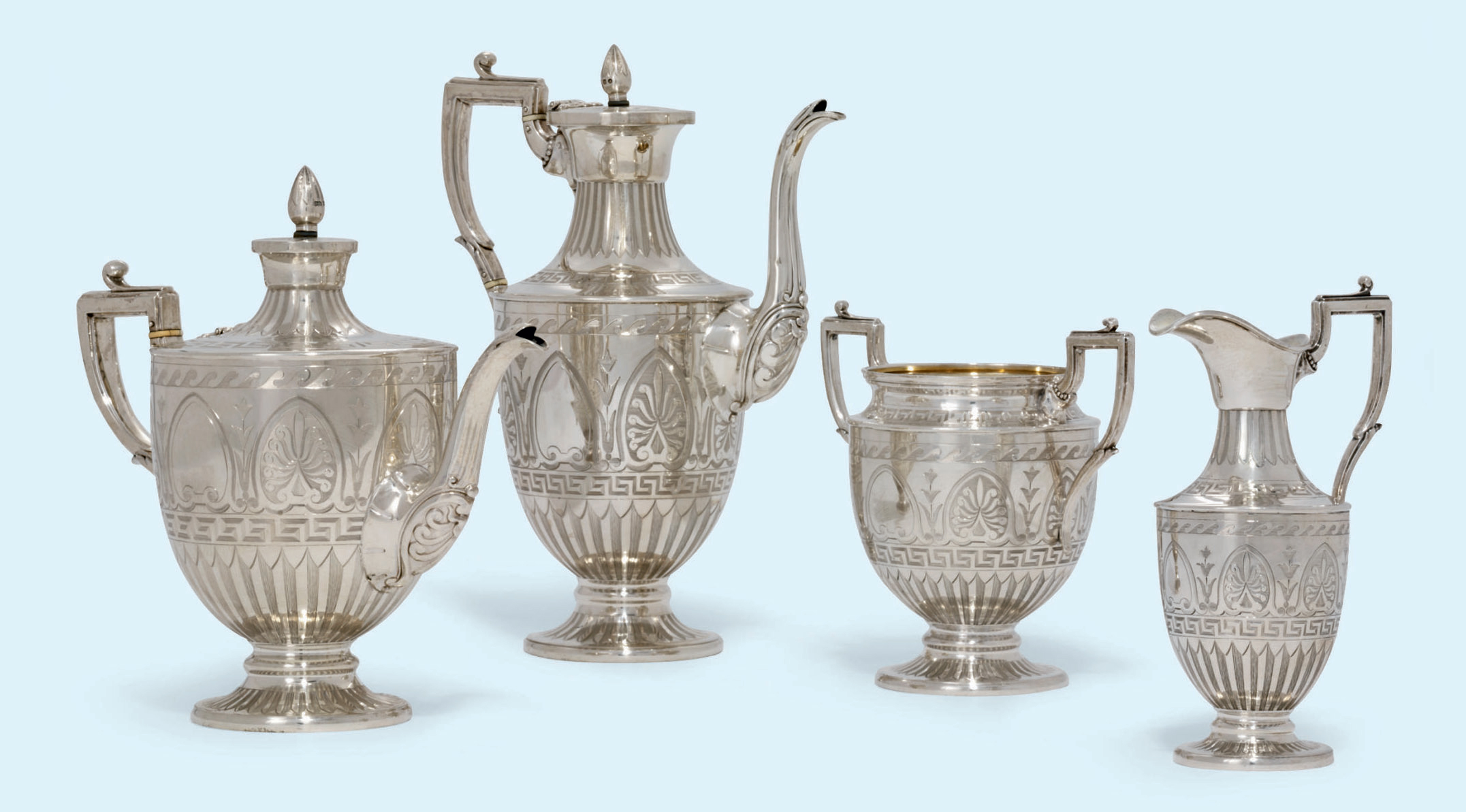 A VICTORIAN FOUR-PIECE SILVER TEA AND COFFEE-SERVICE
