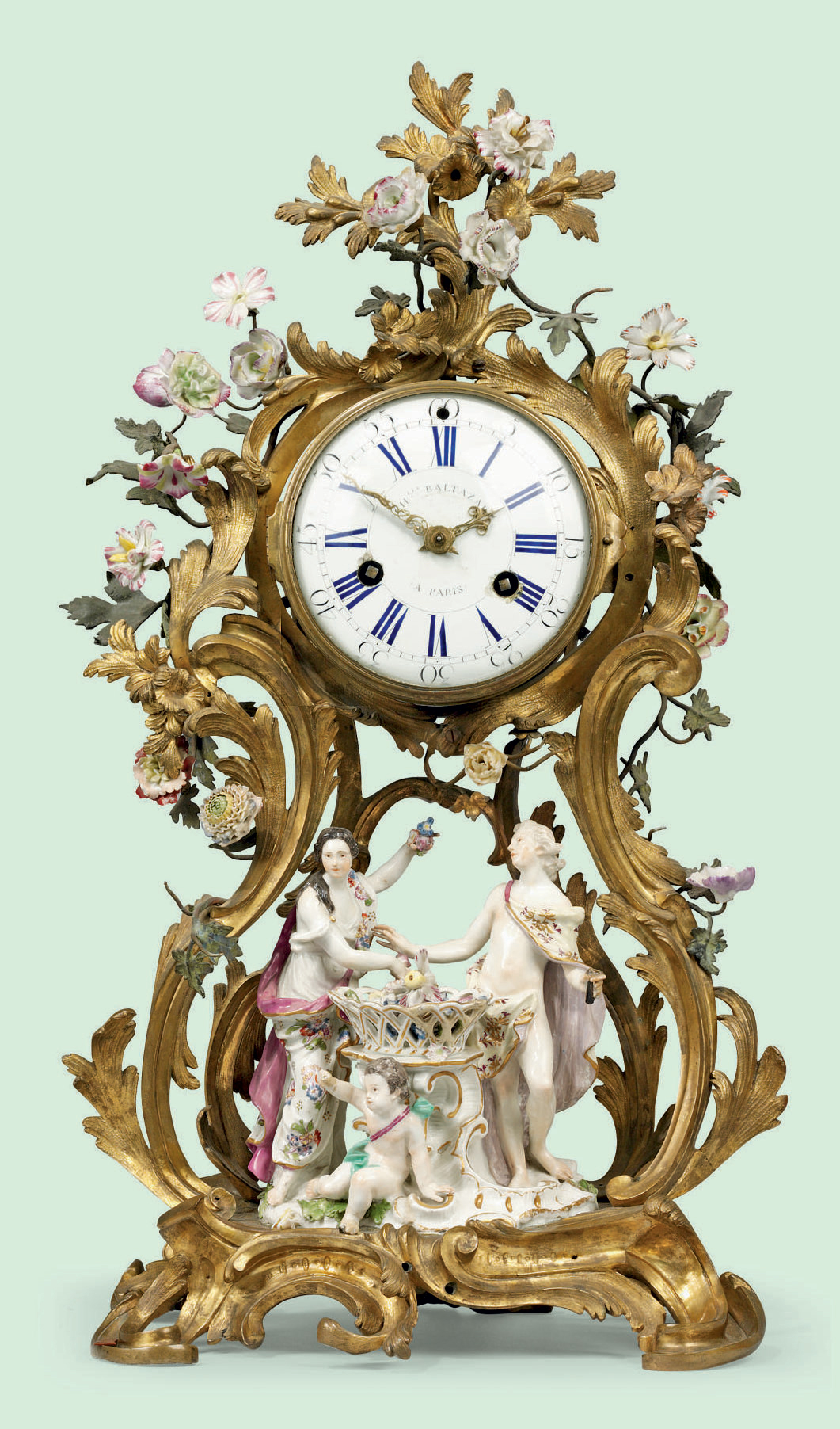 A LOUIS XV ORMOLU-MOUNTED MEISSEN PORCELAIN MANTEL CLOCK