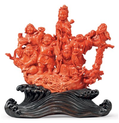 A CHINESE CARVED CORAL FIGURAL