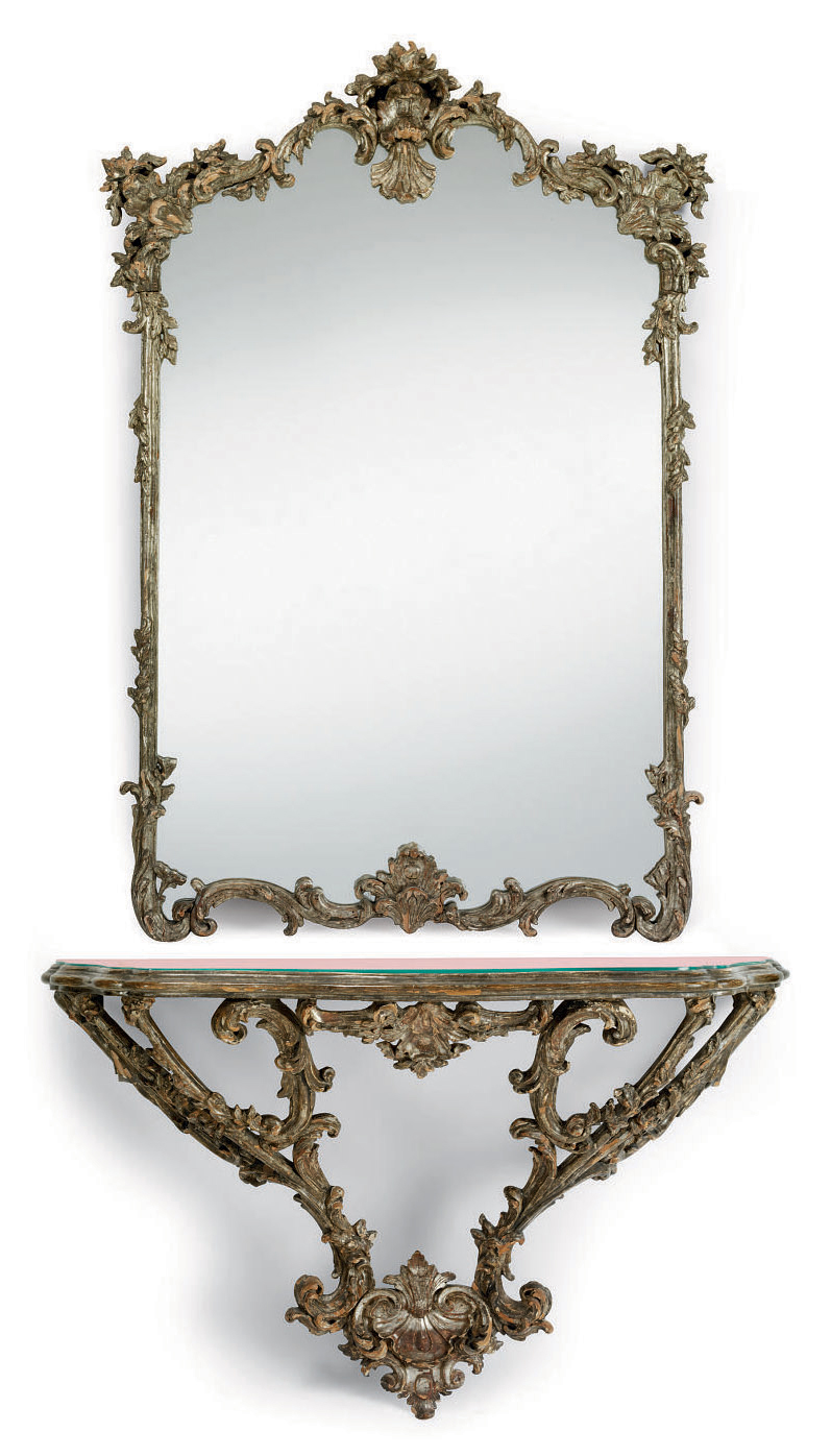 AN ITALIAN CARVED SILVERED WALL MIRROR AND CONSOLE