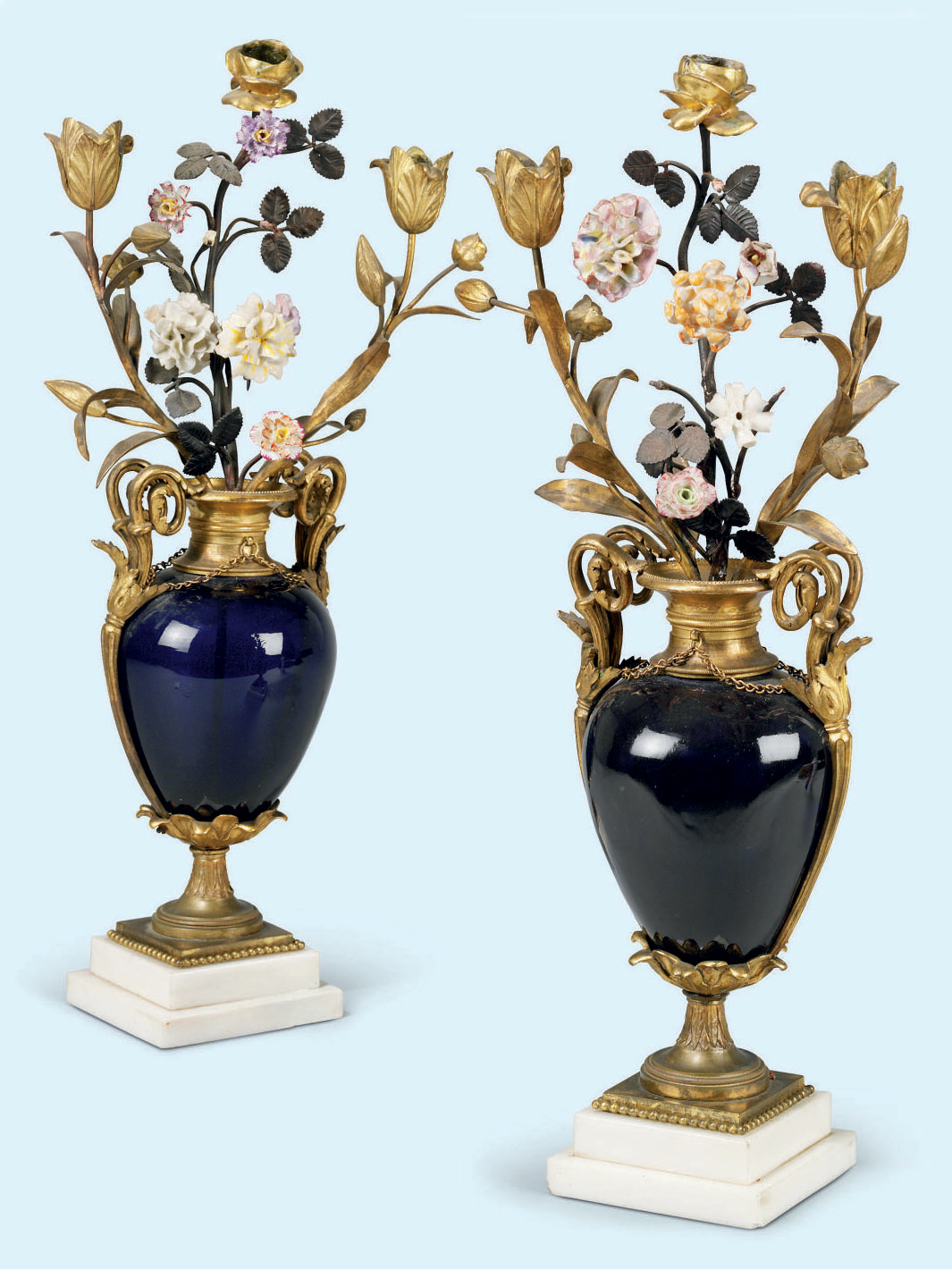 A PAIR OF LOUIS XVI ORMOLU-MOUNTED PORCELAIN AND BLUE GLASS CANDELABRA