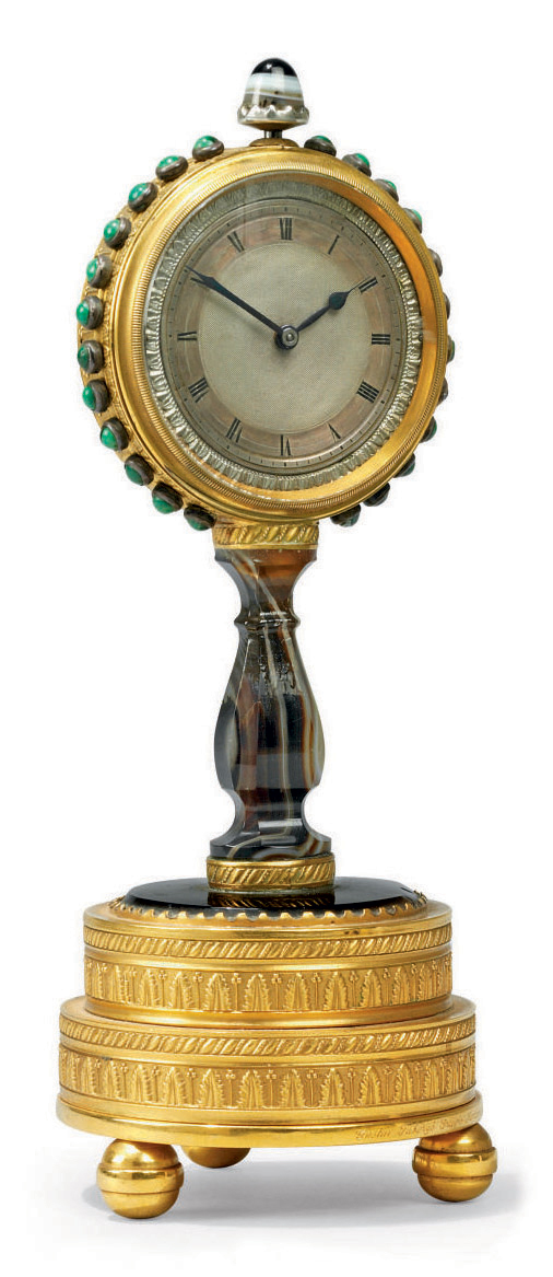 A RUSSIAN COMPOSITE ORMOLU, AGATE AND MALACHITE TIMEPIECE DESK CLOCK