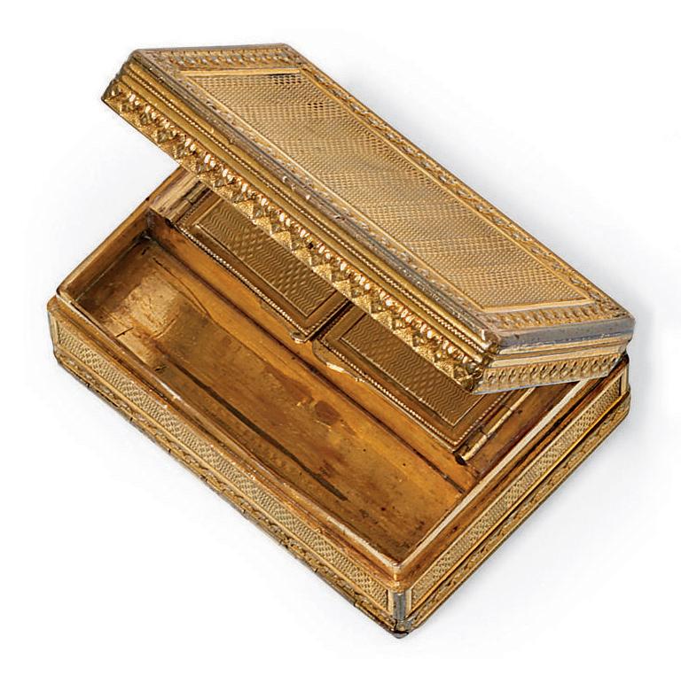 A CONTINENTAL GILT-METAL PATCH-BOX