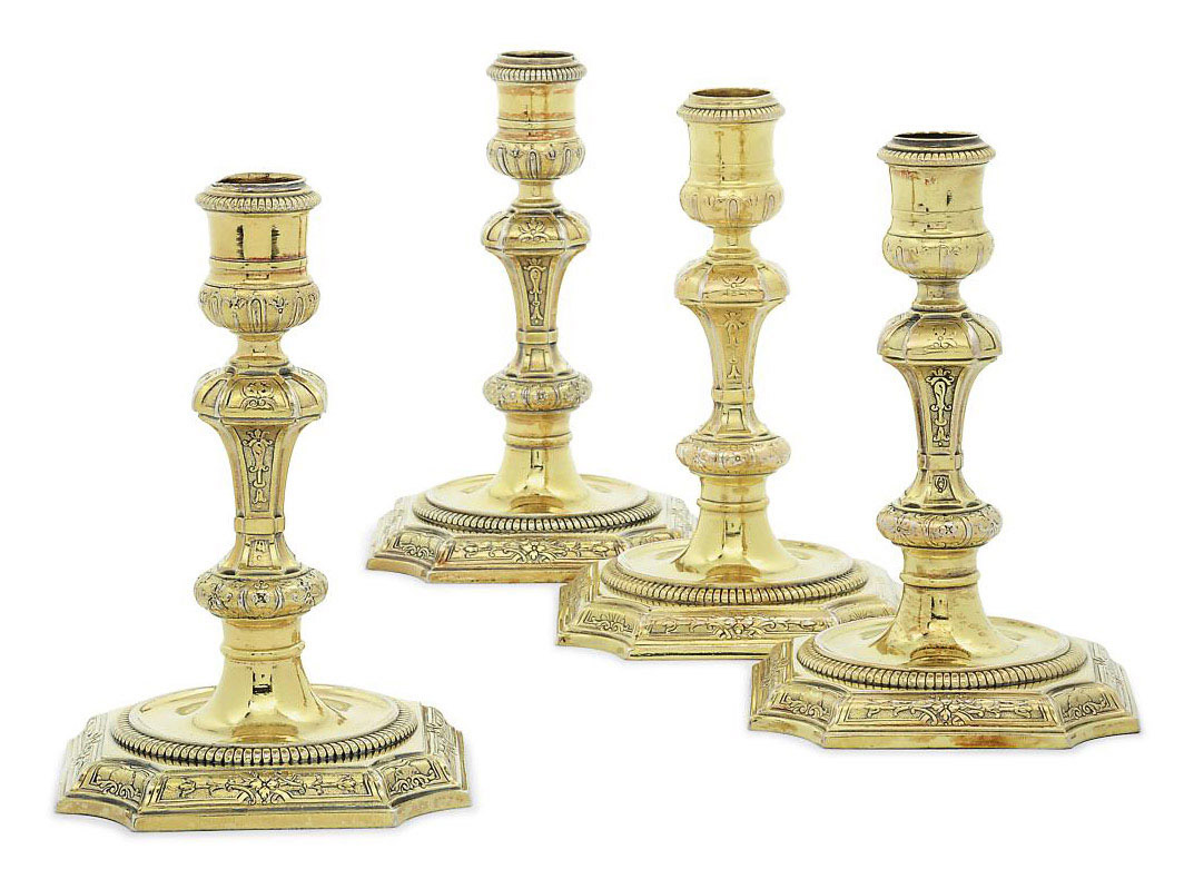 TWO PAIRS OF GEORGE I SILVER-GILT CANDLESTICKS