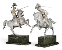 TWO GERMAN PARCEL-GILT SILVER EQUESTRIAN FIGURES