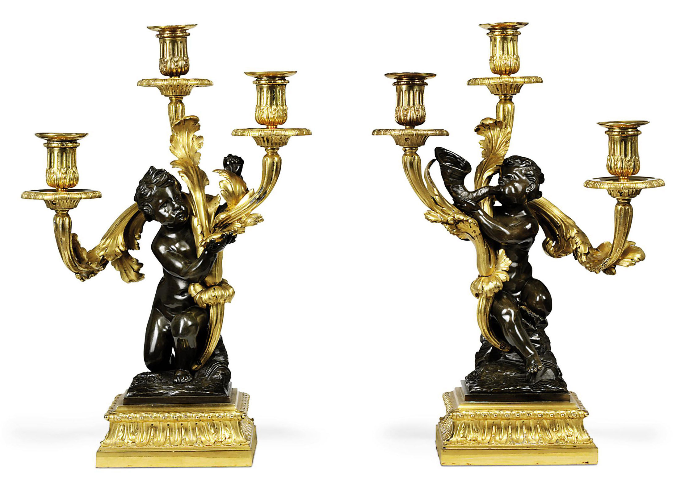 A PAIR OF RESTAURATION ORMOLU AND BRONZE THREE-LIGHT CANDELABRA