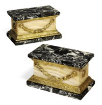 A PAIR OF ROMAN ORMOLU-MOUNTED EGYPTIAN ALABASTER AND BIANCO E NERO MARBLE ARCHITECTURAL PLINTHS