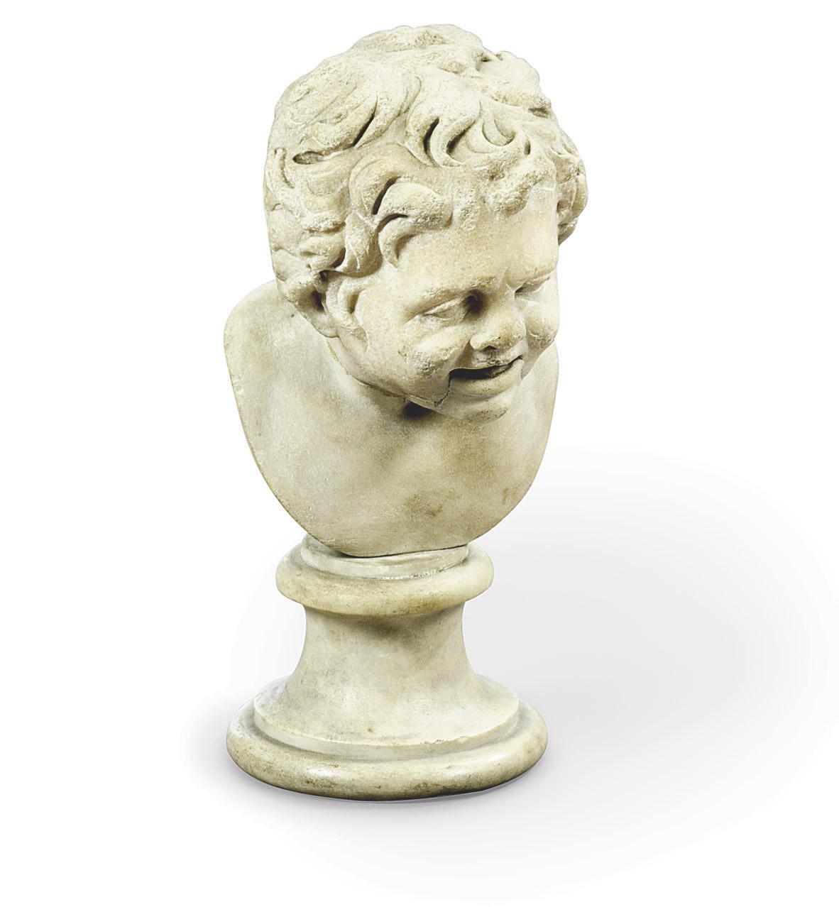 A ROMAN MARBLE HEAD OF A SATYR