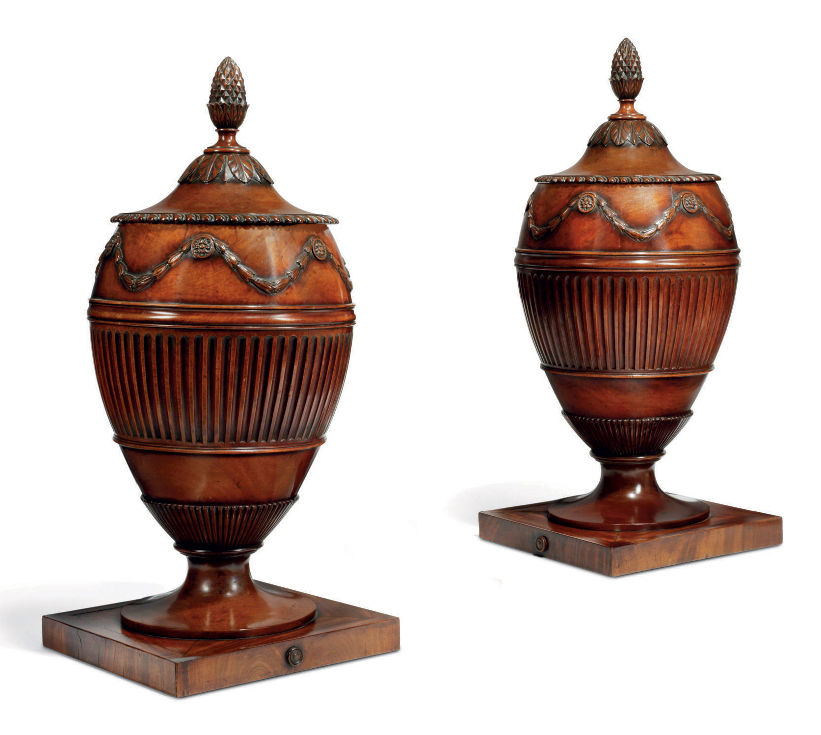 A PAIR OF LATE GEORGE III MAHOGANY WATER URNS