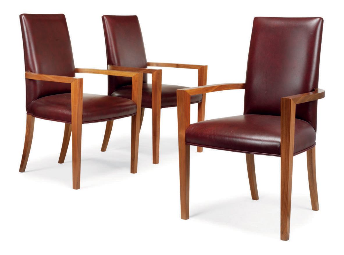 A SET OF THREE CHERRYWOOD 'MOURA' ARMCHAIRS