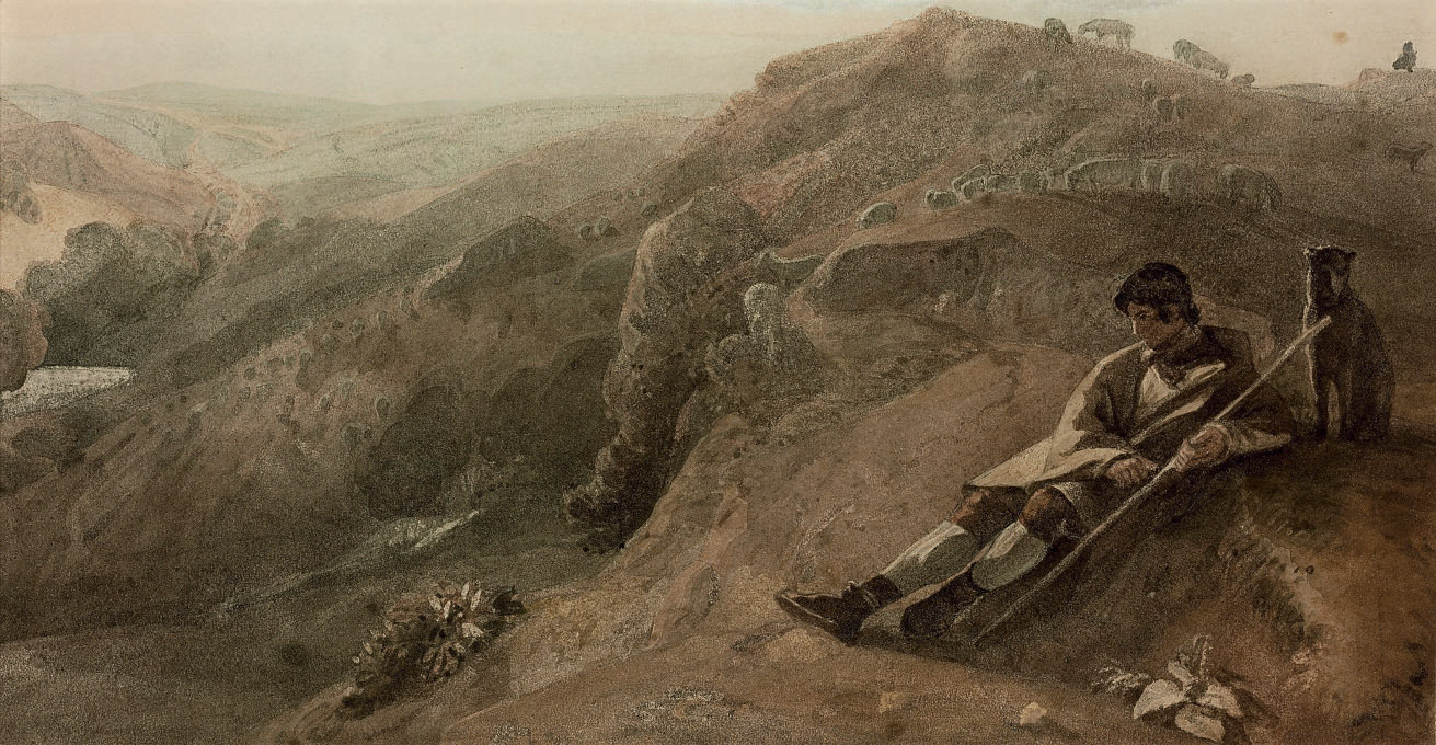 A shepherd seated overlooking a deep valley
