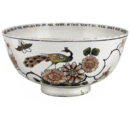 AN ENGLISH DELFT INSCRIBED AND