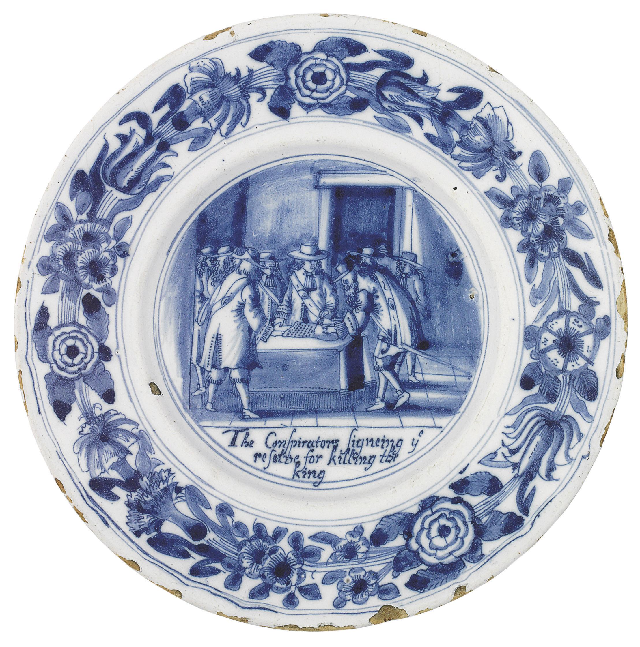 A LONDON DELFT BLUE AND WHITE POPISH PLOT PLATE