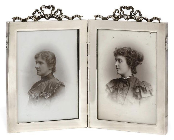 A LATE VICTORIAN SILVER DIPTYC