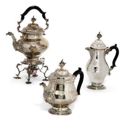 A SILVER TEAPOT AND HOT WATER