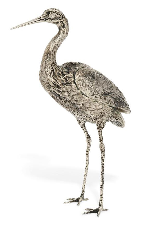 A CONTINENTAL METALWARE TABLE ORNAMENT IN FORM OF A STORK