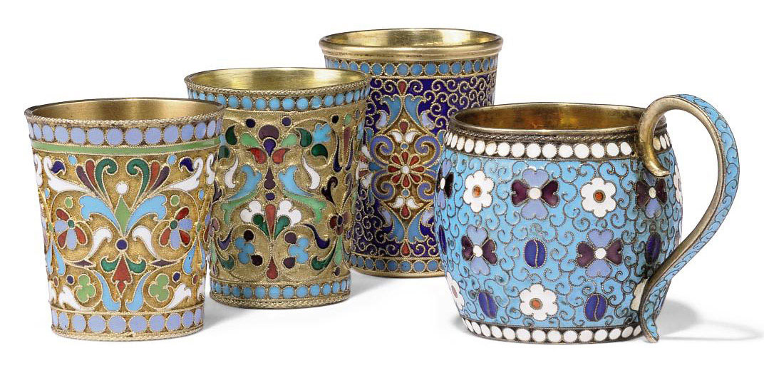 A GROUP OF THREE RUSSIAN SILVER-GILT AND CLOISONNE ENAMEL BEAKERS AND A VODKA CUP