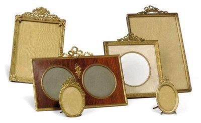 A COLLECTION OF EMBOSSED GILT-