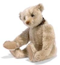 A STEIFF WHITE TEDDY BEAR, (5343,1), jointed, mohair, soft stuffed, boot button eyes, brown stitching with five claws, blank button and side squeaker; with additional leather collar, circa 1906 --16½in. (42cm.) high
