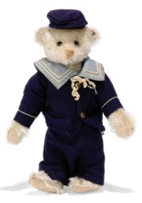 A STIEFF BASA TEDDY BEAR, (15), jointed, white mohair, boot button eyes, brown stitching, no hand pads, inoperative squeaker, blue felt sailor suit and FF button, circa 1910 --8½in. (21.5cm.) high
