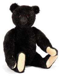 A STEIFF BLACK TEDDY BEAR, (5325,2), jointed, mohair, black boot button eyes, red felt discs behind, black stitching, inoperative growler and FF button, circa 1912 --13½in. (34.5cm.) high (one hand pad replaced, two pads patched and some minor wear)