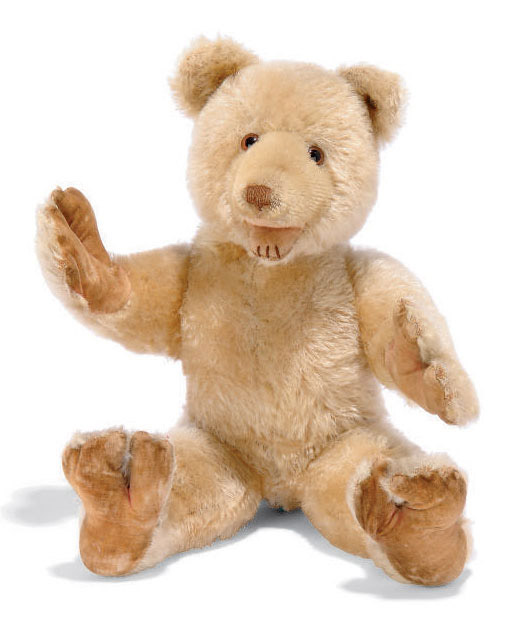 A STEIFF SNAP DICKY, (7525H), standing, jointed arms, light golden mohair, brown and black glass eyes, brown stitched nose and three stitches to bottom lip, spring joints to hands, feet and mouth, tail-operated heading turning mechanism, printed velvet pads and FF button in ear, circa 1933 --12½in. (32cm.) high (some thinning and fading, pads discoloured, some joints inoperative and tail recovered)