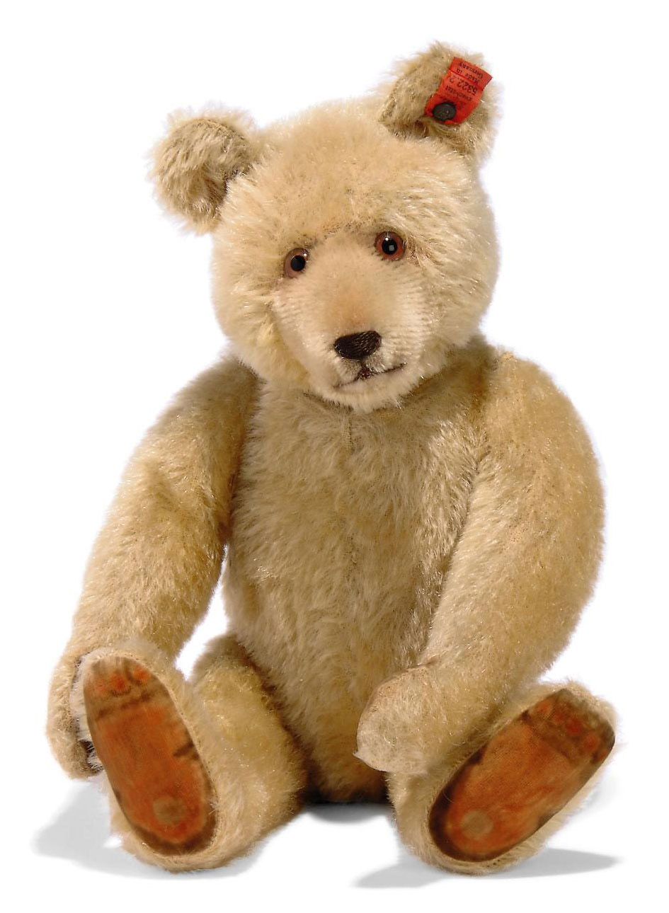 A STEIFF DICKY TEDDY BEAR, (5322,2), jointed, blonde mohair, brown and black glass eyes, inset short mohair muzzle, brown stitching, printed velvet pads, squeaker and FF button with full red cloth tag, 1930s --14in. (35.5cm.) high (slight thinning, wear and fading, red tag a little creased)