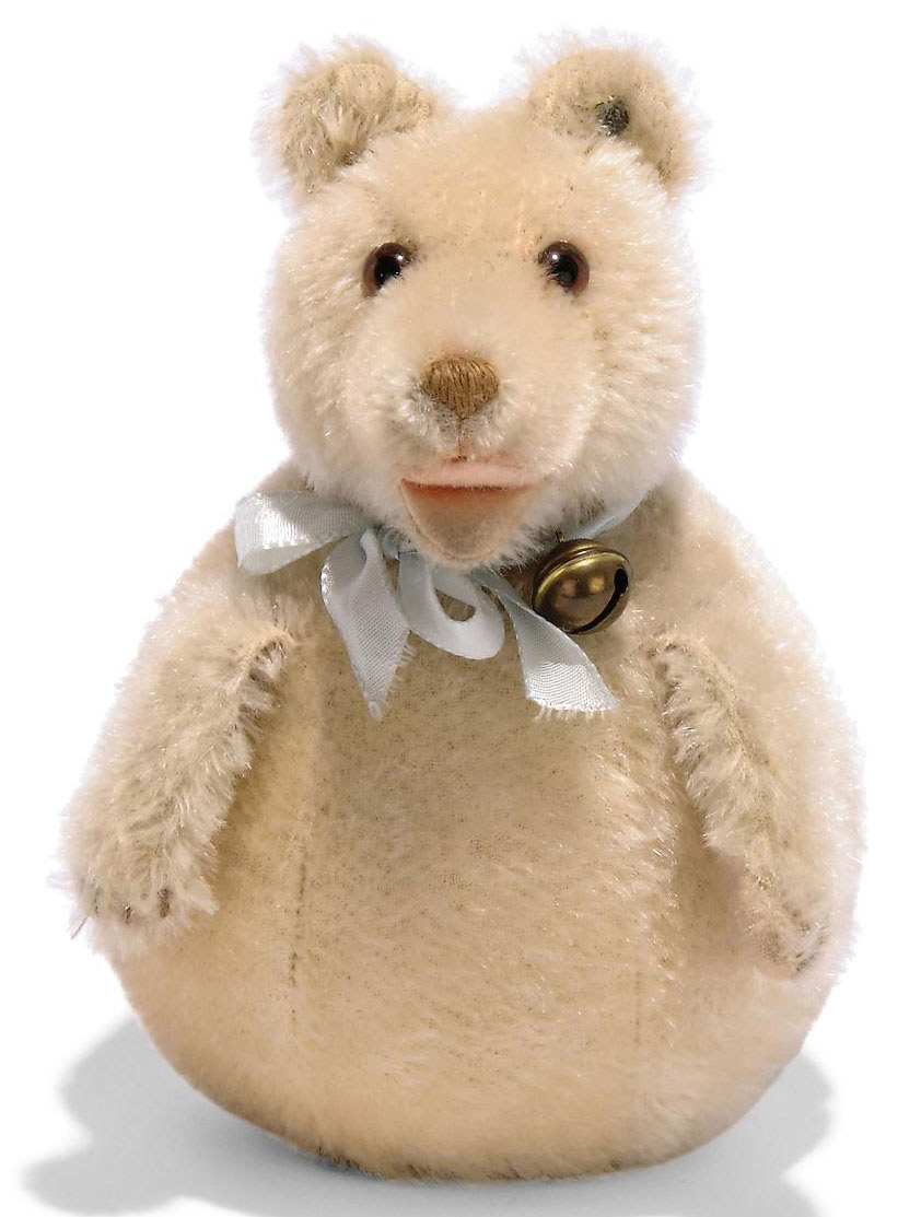 A STEIFF ROLY-BEAR, (320), cream mohair Teddy Baby, jointed head, loose handing arms, open mouth, brown and black glass eyes, brown stitching, bell on ribbon and FF button with remains of yellow tag, 1937-42 --7in. (18cm.) high (some slight thinning, fading and general wear)