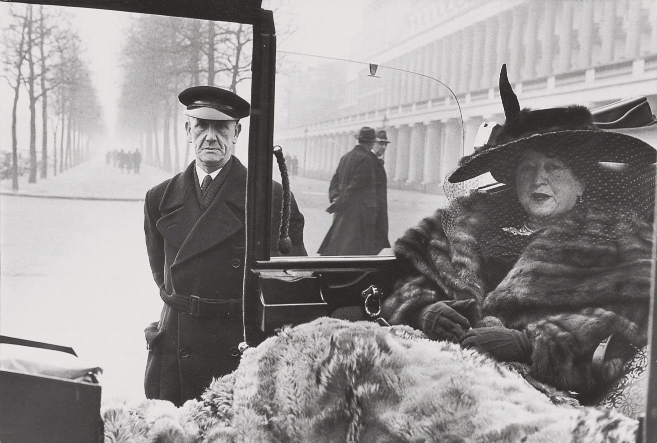Mrs Eveleigh Nash with her chauffeur, at Buckingham Palace Mall, 1953