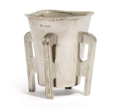 A VICTORIAN SILVER CUP ON FOUR