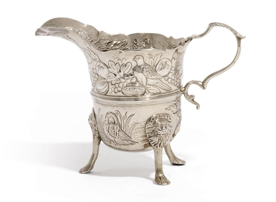 A GEORGE II IRISH SILVER CREAM-JUG