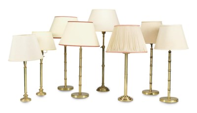 A SET OF FOUR LACQUERED BRASS