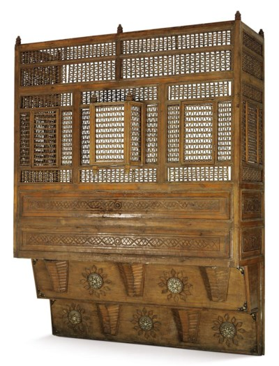 AN OTTOMAN INLAID AND STAINED