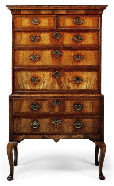 A GEORGE II WALNUT CHEST-ON-ST