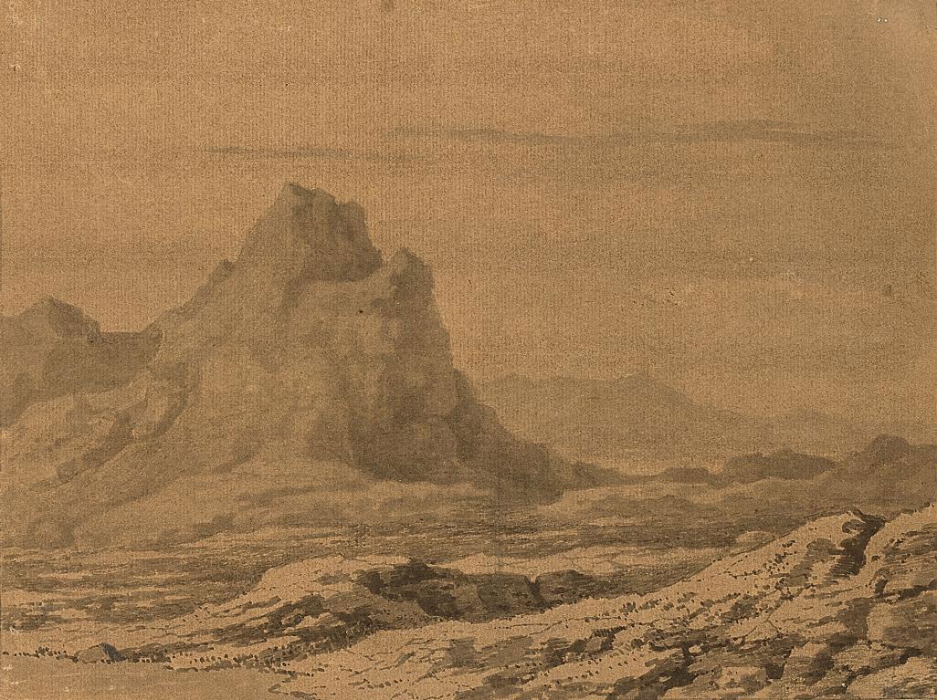 A mountain peak in a rocky landscape