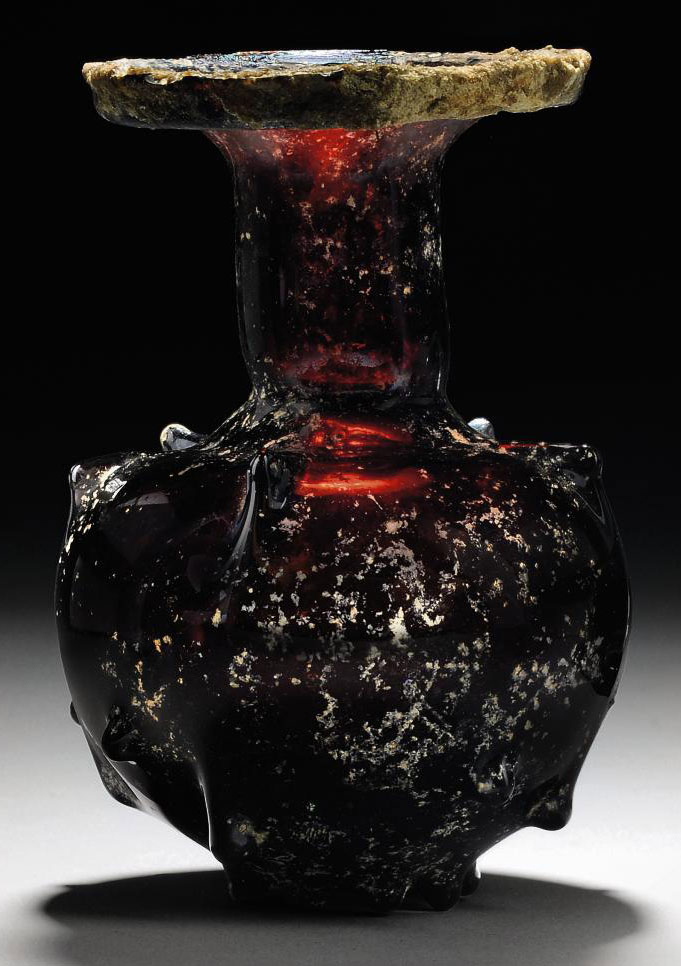 A ROMAN AUBERGINE GLASS SPRINK
