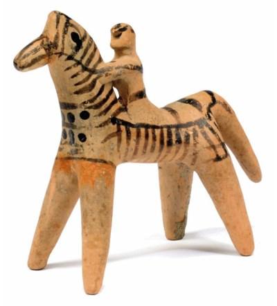 A BOEOTIAN TERRACOTTA HORSE AN