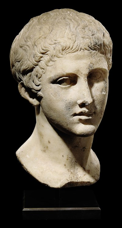 A ROMAN MARBLE BUST OF AN ATHL