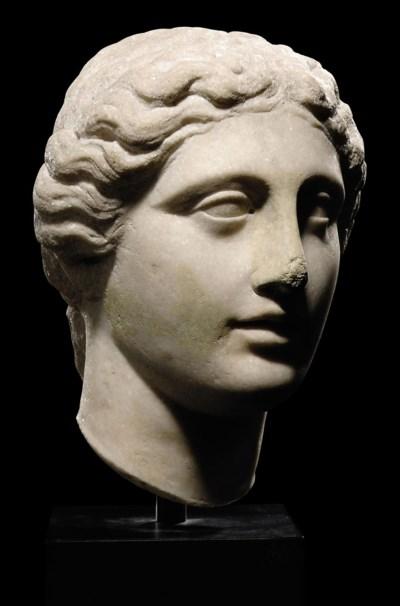 A ROMAN MARBLE HEAD OF APHRODI