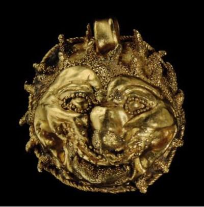 AN ETRUSCAN GOLD LION HEAD PEN