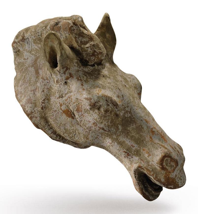 A GREEK TERRACOTTA HORSE HEAD
