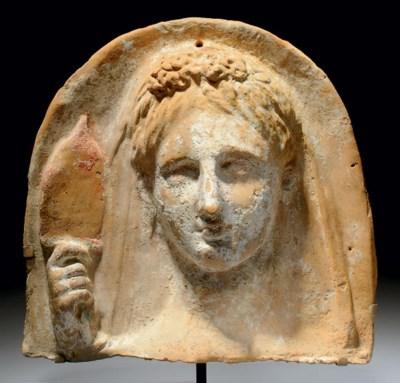 A GREEK TERRACOTTA FEMALE BUST