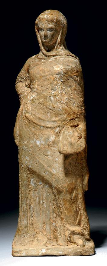 A GREEK TERRACOTTA FIGURE OF WOMAN