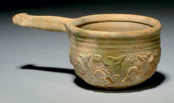A ROMAN LEAD GLAZED POTTERY PA