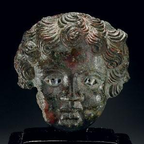 A ROMAN BRONZE HEAD OF A CHILD