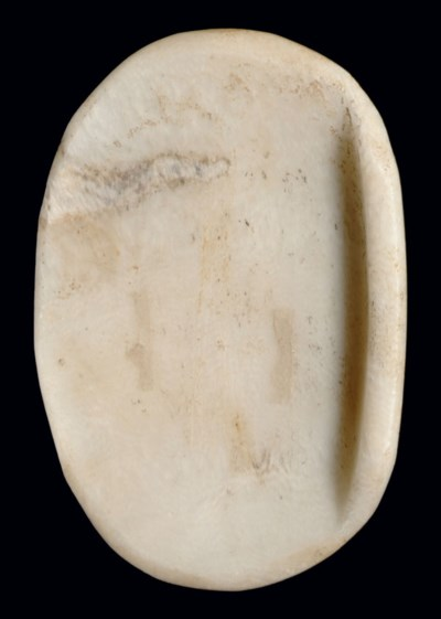 AN EGYPTIAN ALABASTER PALETTE