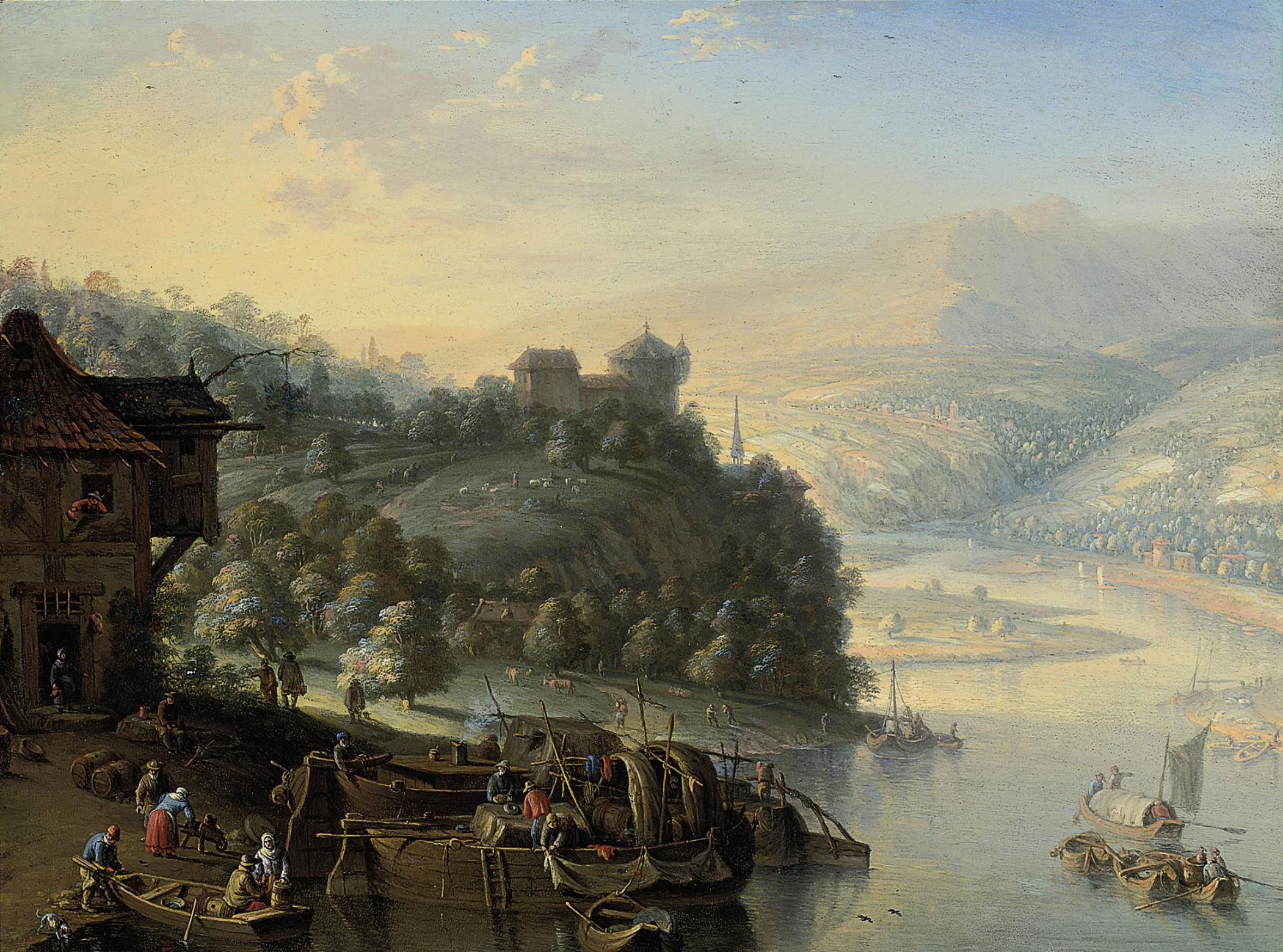 A Rhenish landscape with boats on a riverbank