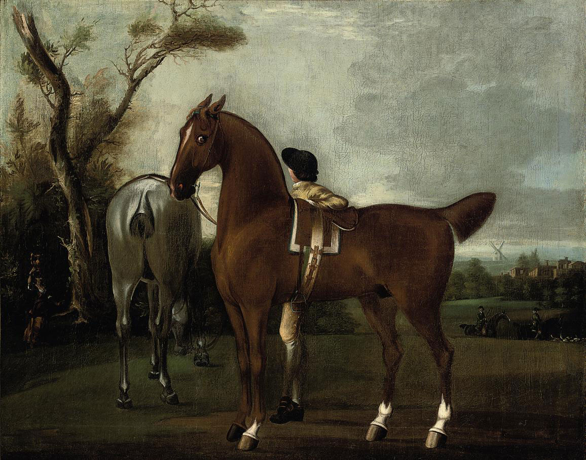 A groom with two hunters in a landscape, a windmill beyond